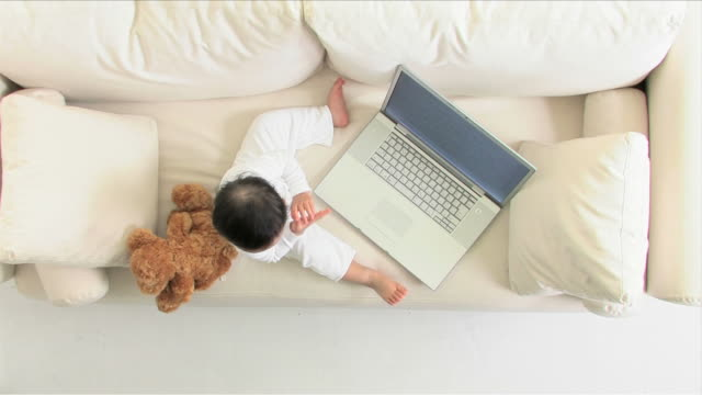one baby is using a laptop - one baby girl only stock videos & royalty-free footage