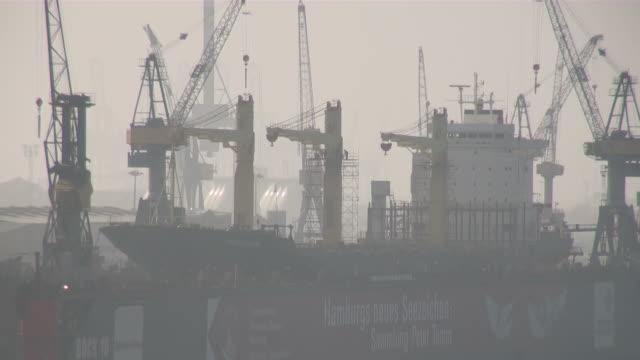 ws one big ferry laying in dry dock of blohm & voss shipyard at foggy climate / hamburg, hamburg, germany - shipyard stock videos & royalty-free footage