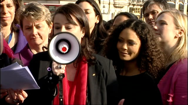 'One Billion Rising' campaign against violence for women flashmob Woman welcomes attendees through megaphone SOT / Thandie Newton listening / Thandie...