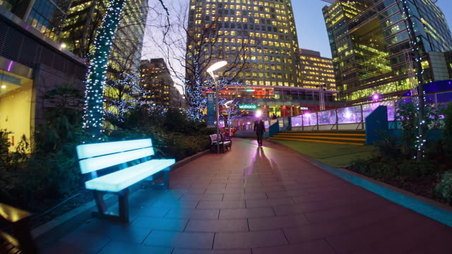 one canada sqaure tower aka canary wharf in london's docklands. - walking point of view stock videos and b-roll footage