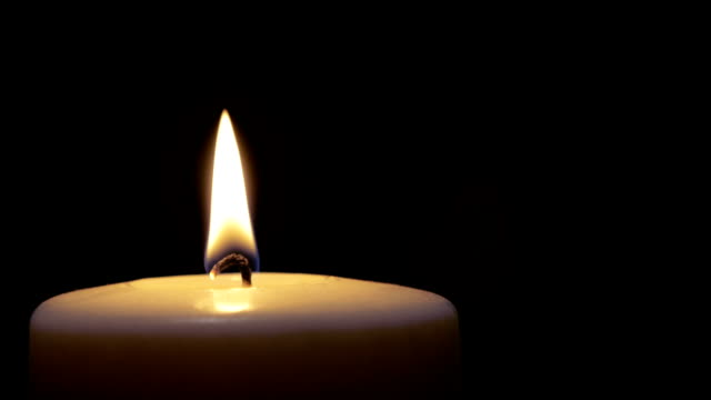 one candle burning - single object stock videos & royalty-free footage