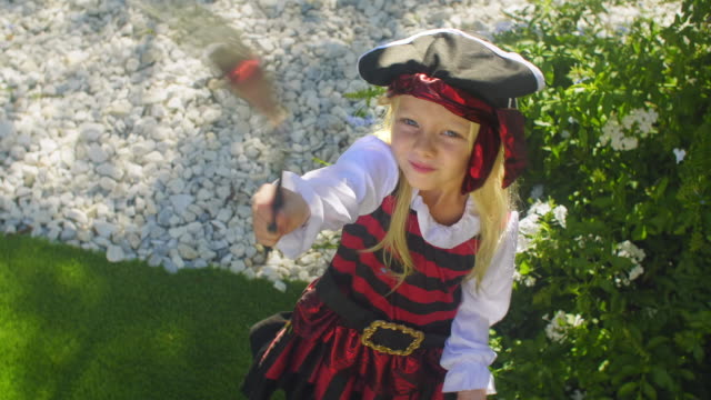 stockvideo's en b-roll-footage met one child in pirate costume waving toy sword - zwaard