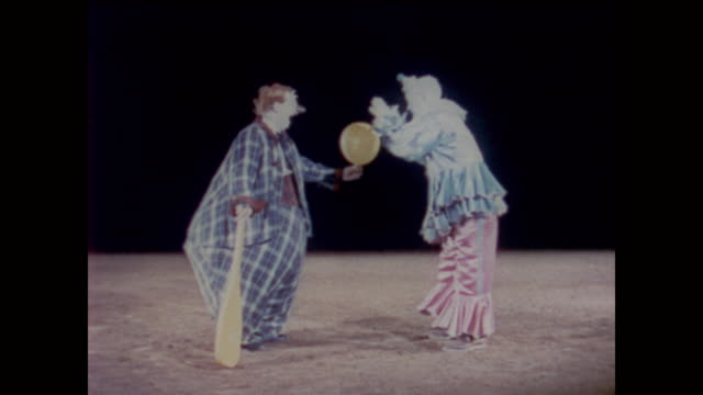 1958 one clown strikes another on the behind demonstrating the sensation of touch - clown stock videos & royalty-free footage