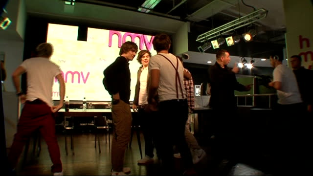 'one direction' boy band meet fans england london hmv photography** vairous shots of one direction band members onto stage and greeting screaming... - boy band stock videos & royalty-free footage