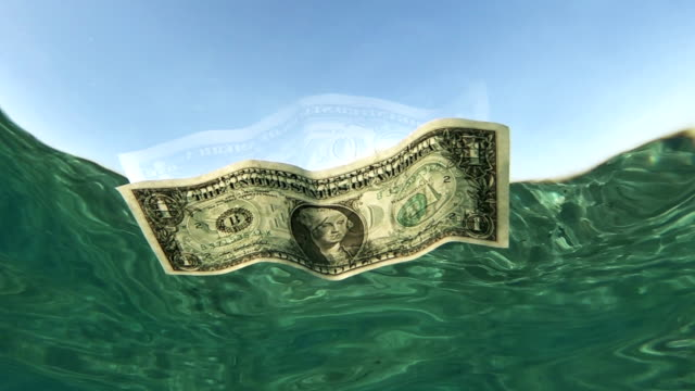 one dollar bill floating in sea water - american one dollar bill stock videos & royalty-free footage