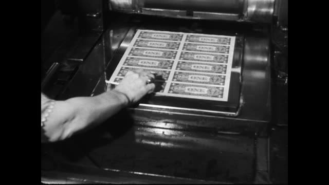 / one dollar bills being printed rolling off the presses / worker picks up sheet of dollar bills to show the engraver's plates underneath / plates... - american one dollar bill stock videos & royalty-free footage