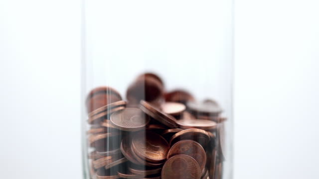 cu td one euro cent coins falling into jar - saving up for a rainy day stock videos and b-roll footage