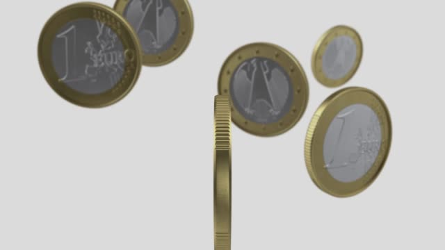 one euro coins are falling on white background in 4k resolution with alpha channel - european union coin stock videos & royalty-free footage