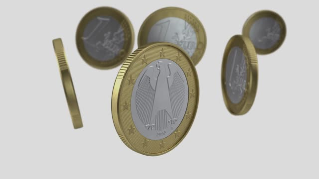 one euro coins are turning on white background in 4k resolution with alpha channel - european union coin stock videos & royalty-free footage