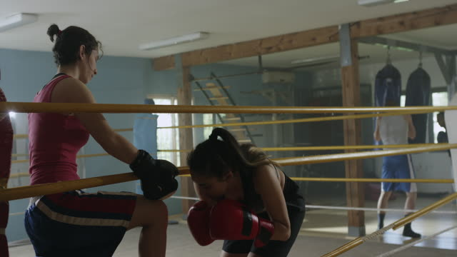 one female boxer helping other to enter in the ring - boxing ring stock videos & royalty-free footage