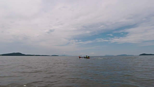 one fisherman in traditional fishing boat at sea - andaman sea stock videos & royalty-free footage