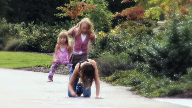 ms  one girl drawing hopscotch with chalk on sidewalk and two girls skip and play hopscotch  / langley, british columbia, canada. - kelly mason videos stock videos & royalty-free footage