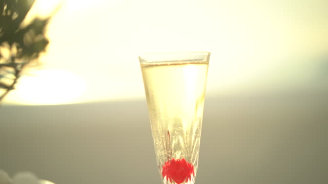 one glas of champagne at sunset