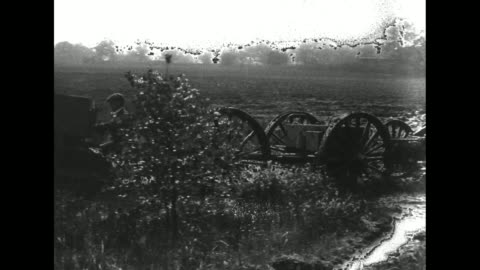 vidéos et rushes de one holt caterpillar tractor pulls several caissons across field and through stream and mud / note: exact day/month not known; film has nitrate... - caterpillar inc.