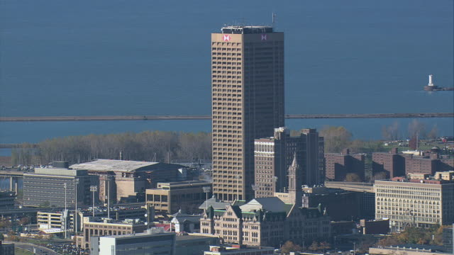 aerial one hsbc center looming over other buildings and lake erie, with lighthouse beyond / buffalo, new york, united states - ominous stock videos & royalty-free footage