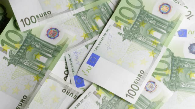 one hundred euro-banknotes turning - euro symbol stock videos and b-roll footage