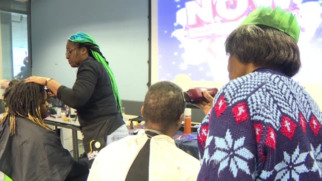 one hundred homeless people and rough sleepers enjoy a christmas eve lunch and a range of free services including hairdressing an optician and art... - afp stock videos & royalty-free footage