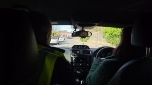 One in five roads urgently need repair as councils lack money to fix potholes ENGLAND Greater Manchester Bolton Various of reporter in car with Gina...