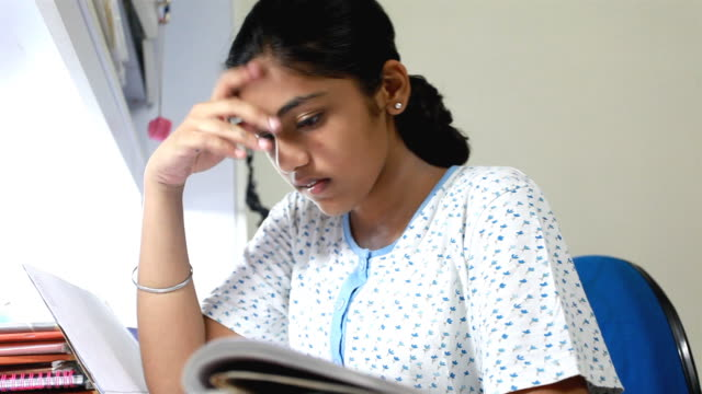 One Indian Teenage Girl Studying at Home