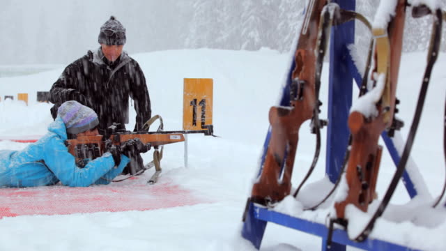 ms one instructor giving instruction to woman about biathlon range rifle / whistler ,bc ,canada - biathlon stock videos and b-roll footage