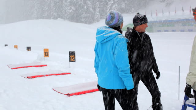 ms pan one instructor teaching about biathlon range rifle / whistler ,bc ,canada - biathlon stock videos and b-roll footage