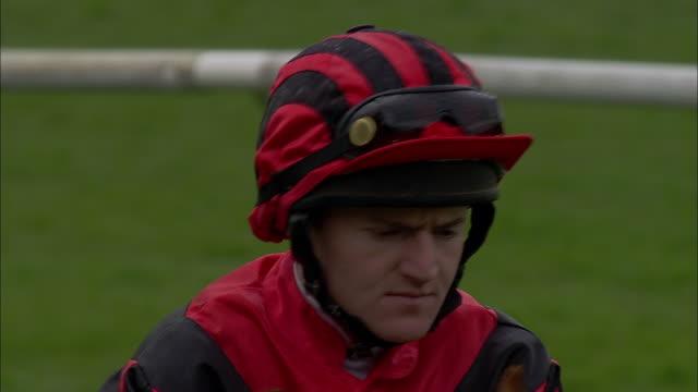 cu one jockey on horseback walking at newbury racecourse / newbury, england, uk - newbury england stock videos & royalty-free footage