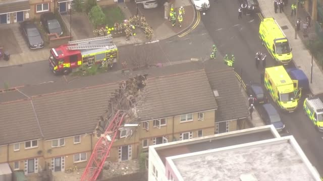 one killed and four injured following crane collapse in east london england london bow ext *** john biggs live interview overlaid collapsed crane... - crane stock videos & royalty-free footage