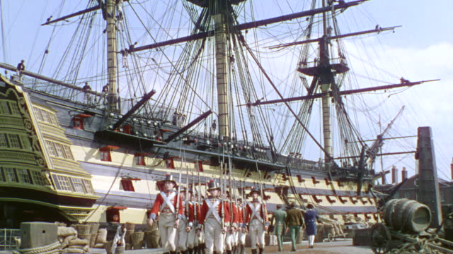 ws one large ship at harbor with crew and troop marching - rigging stock videos & royalty-free footage