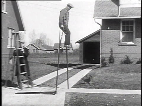 1930 ws one legged man using very tall crutches / galeseburg, illinois, usa - 1930 stock-videos und b-roll-filmmaterial