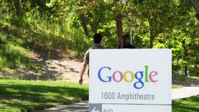 one long shot of the outside of google headquarter / google signage / employees walking past signage google employees signage on july 07 2011 in... - google brand name stock videos and b-roll footage