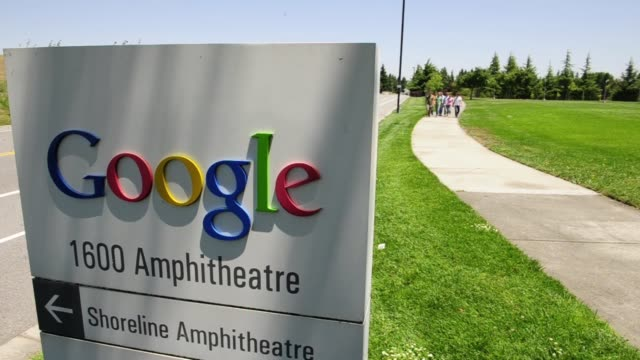 One long shot of the outside of Google headquarters / Google sign with a group of employees walking past Google Employees Outside on July 07 2011 in...