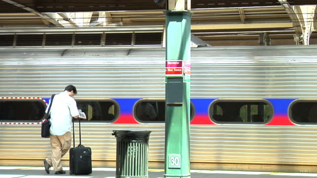 one man and a train as it departs - subway train stock videos & royalty-free footage