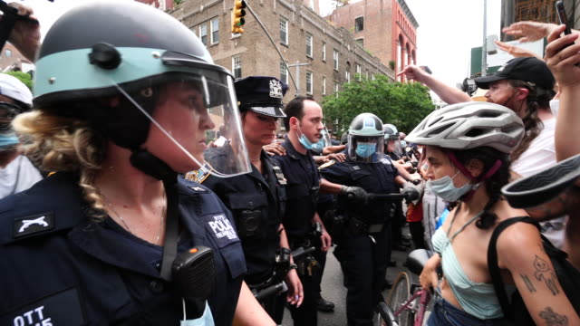 one man arrested by police. blm demonstrators clash with the police force at washington square park in new york city on 50th annual of pride march in... - arrest stock videos & royalty-free footage