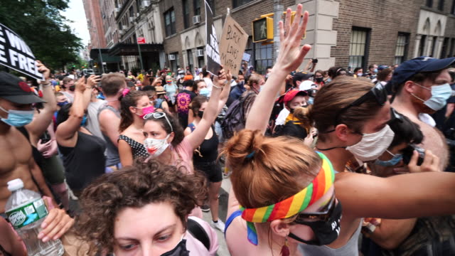 one man arrested by police. blm demonstrators clash with the police force at washington square park in new york city on 50th annual of pride march in... - protestor stock videos & royalty-free footage