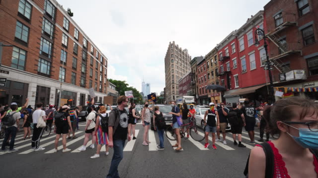 one man arrested by police. blm demonstrators clash with the police force near washington square park on 50th annual of pride march in greenwich... - placard stock videos & royalty-free footage