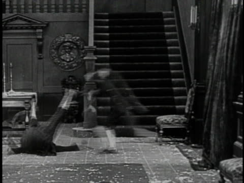 1920 montage one man attacking another and violently throwing him against the floor before tossing him out the door onto a passing police officer - romantic comedy stock videos and b-roll footage