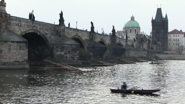ms one man fishing near charles bridge / prague, hlavni mesto praha, czech republic - charles bridge stock videos and b-roll footage