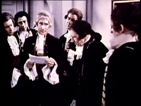 vídeos y material grabado en eventos de stock de 1969 reenactment ms one man reading statement with others gathered around and listening intently as the continental congress officially adopts the design of the american flag in 1777 / united states - 18th century
