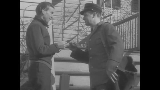 vidéos et rushes de 1938 one man receives news of new job and one man receives unemployment benefits - facteur