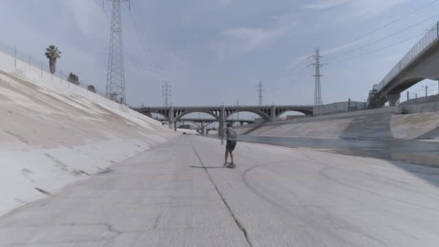 one man skateboarding in the la river - concrete stock videos & royalty-free footage