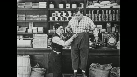1919 one man (buster keaton) takes another man's (fatty arbuckle) measurements - 1910 1919 stock videos & royalty-free footage