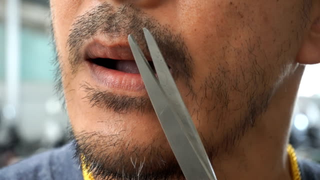 one man used a pair of scissors to trim his mustache. - sideburn stock videos & royalty-free footage