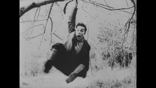 1918 one monkey man (al st. john) chases another (buster keaton) - runaway stock videos & royalty-free footage