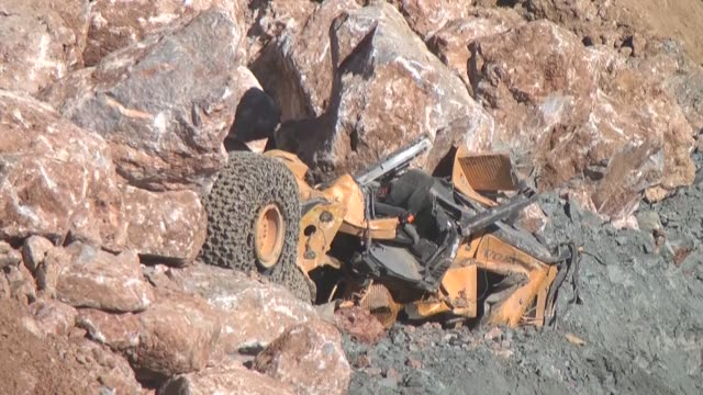 one more worker's body is pulled from the wreckage during rescue operation after a copper mine collapsed in turkey's southeastern province of siirt... - copper mine stock videos and b-roll footage