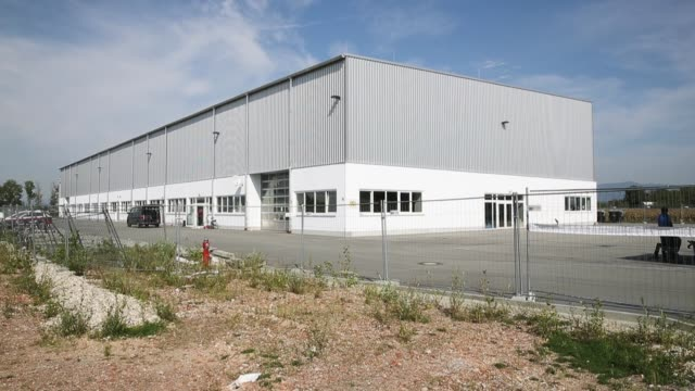 one of bavaria's newlyintroduced 'anchor centers' for asylum applicants at a former warehouse stands in an industrial park near stephansposching on... - deported stock videos & royalty-free footage