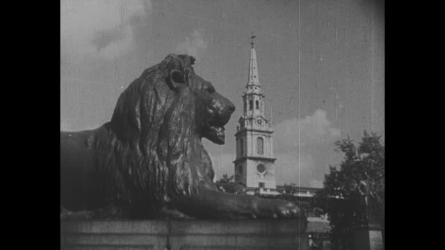 one of four trafalgar square landseer lion statues, church steeple of st martin-in-the-fields in background / note: exact year not known - courtyard stock videos & royalty-free footage