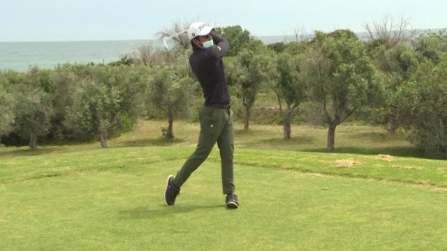one of italy's best known golf clubs reopens after two months of lockdown with a handful of players returning to the links under new social... - golf links stock videos & royalty-free footage