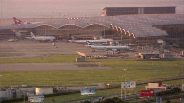ws ha one of terminals of hong kong international airport with jets and support vehicles, hong kong, hong kong, china - hong kong international airport stock videos and b-roll footage