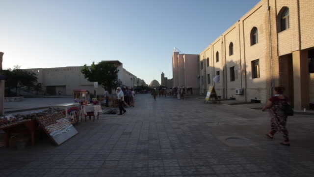 One of the central streets in Bukhara, Uzbekistan on sunset