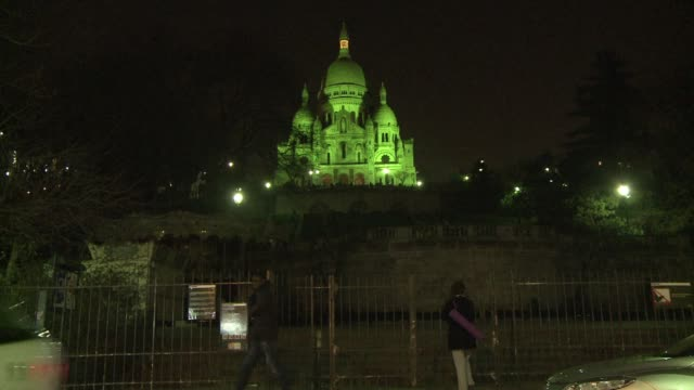 one of the french capital's most famous monuments the sacre coeur basilica was lit up in green on tuesday night to celebrate ireland's patron saint... - basilique du sacre coeur montmartre stock videos & royalty-free footage